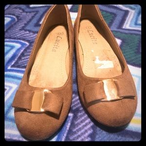 Tanish brown flats with gold bow detail